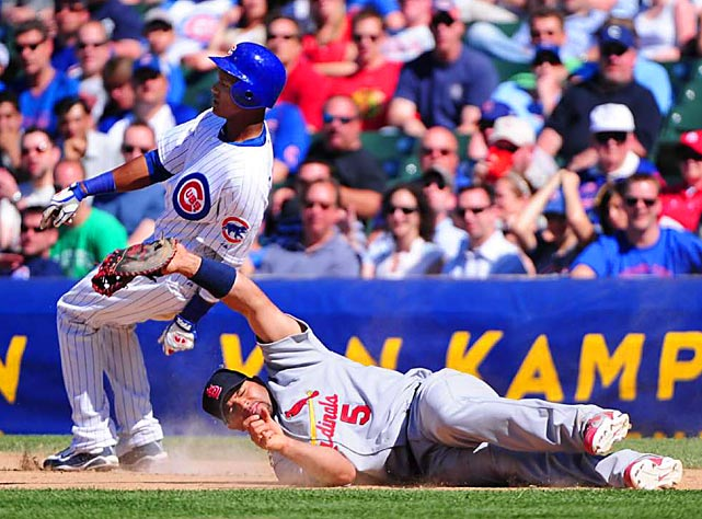 Chicago Cubs shortstop Starlin Castro is safe at first as the throw pulls St. Louis first baseman Albert Pujols off the bag during the Cardinals 7-1 victory on May 28 at Wrigley Field.