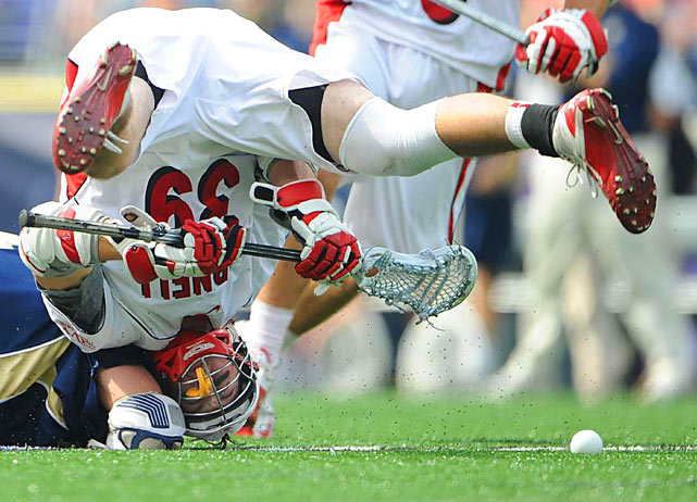 Notre Dame's Trever Sipperly and Cornell's Austin Boykin fight for the ball in the first half of their NCAA Men's Final Four semifinal lacrosse game May 29 in Baltimore. Notre Dame defeated Cornell 12-7.