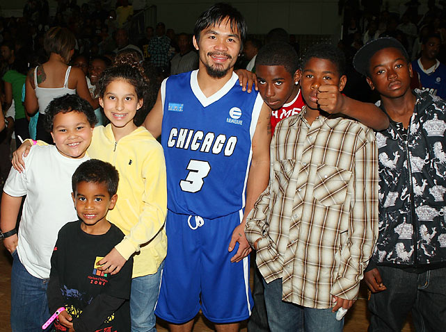 Pacquiao with kids at Ball Up's Street Ball Tour at the Dub Auto Show in Los Angeles.