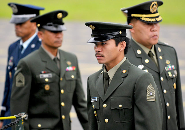 Pacquiao walks with fellow officers before receiving a Legion of Honor award for being an outstanding military athlete.