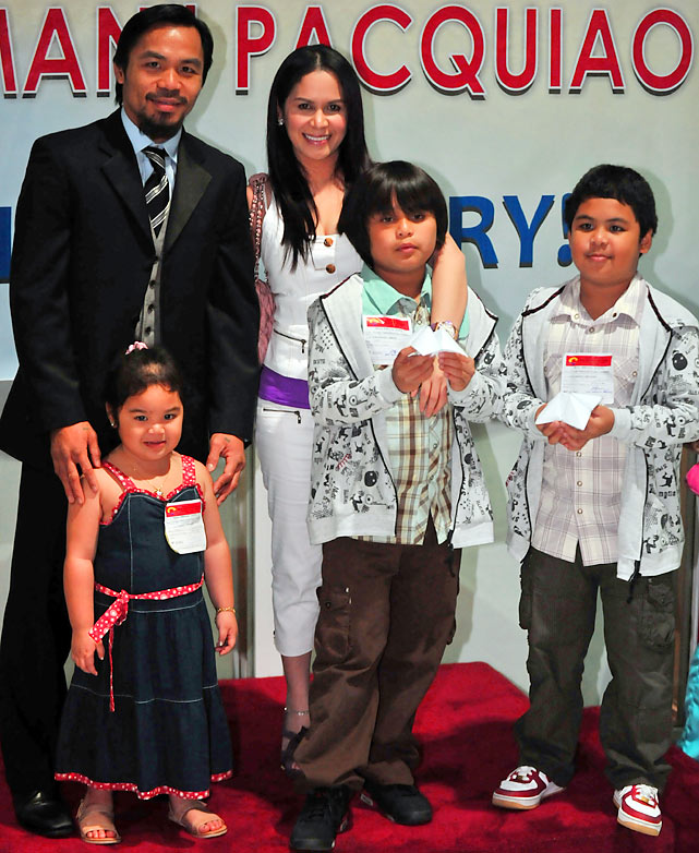 Pacquiao with his wife Jinkee, sons Jimuel and Michael and daughter Princes after his bout against Clottey.