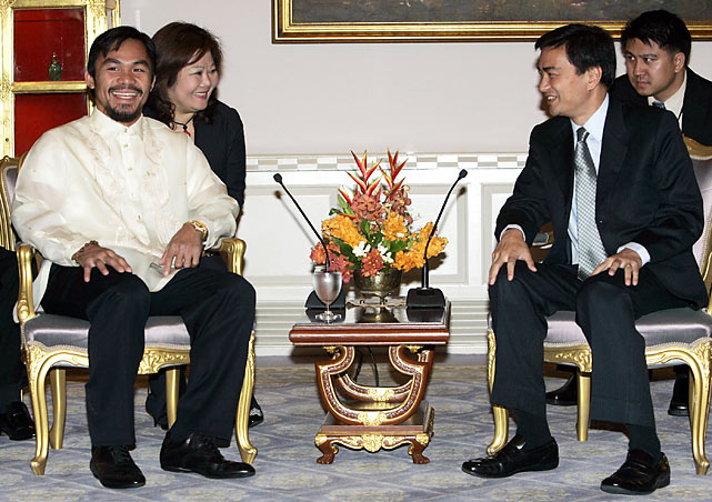 Pacquiao meets Thailand's Prime Minister Abhisit Vejjajiva at the government house in Bangkok.