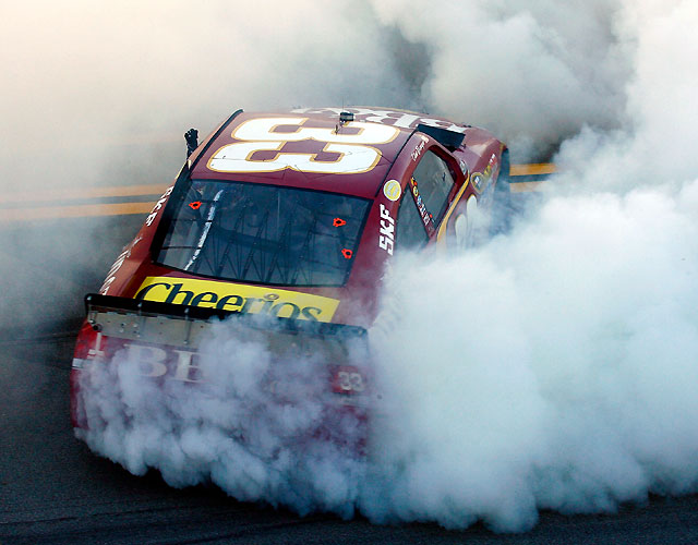 A last-lap caution forced NASCAR to go to replay before it named Clint Bowyer the winner over Kevin Harvick. It was the second win of the Chase for Bowyer and the first of his Cup career on a restrictor-plate track.