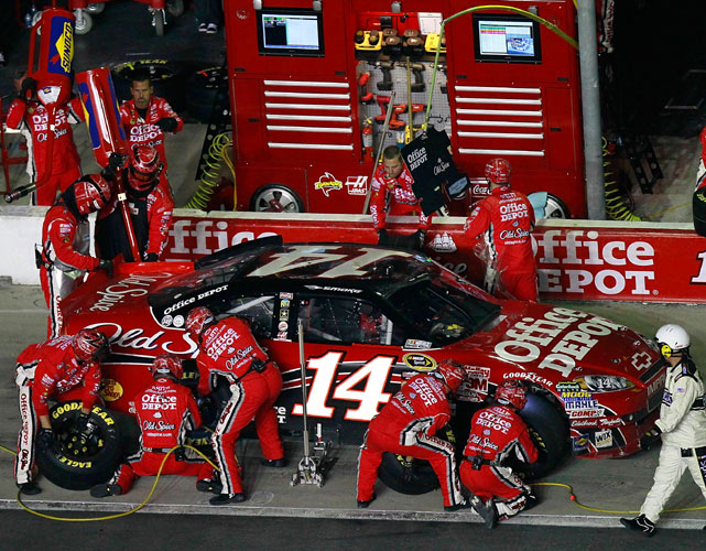 Tony Stewart raced to his first Sprint Cup victory of the year, pulling away from Carl Edwards off the final restart at Atlanta Motor Speedway. Stewart edged Edwards by 1.316 seconds in the 325-lap race to clinch a spot in the 12-man Chase for the Cup.