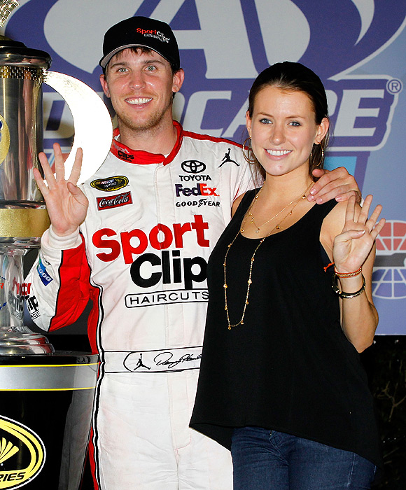Denny Hamlin and girlfriend Jordan Fish celebrate his second straight Sprint Cup race victory in Atlanta.