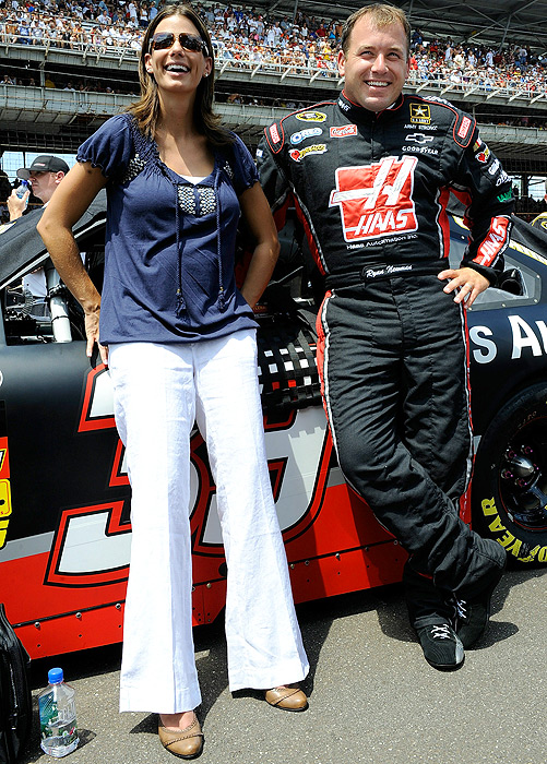 Ryan Newman and wife Krissie enjoy each other's company before the start of the Brickyard 400 in 2010.