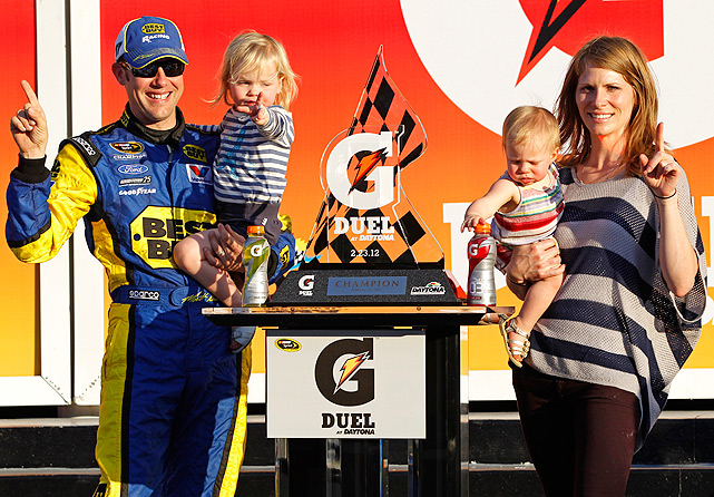 Matt Kenseth and his wife Katie hold their two daughters Kaylin and Grace after the second of two NASCAR Gatorade Duel 150 qualifying auto races in Daytona Beach.