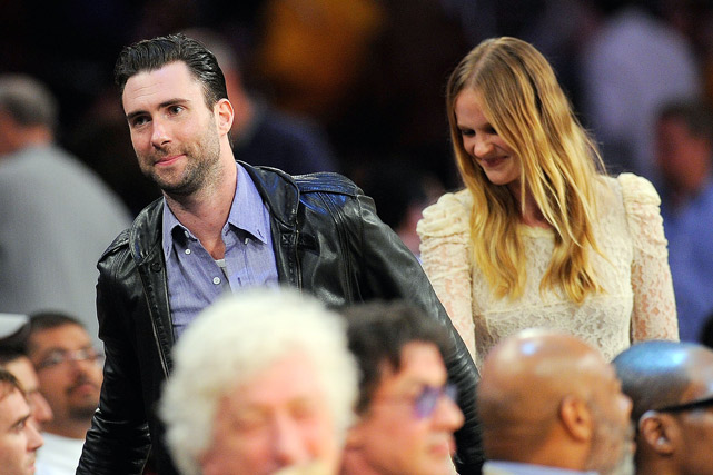 Singer Adam Levine (of Maroon 5) takes his lady friend and swimsuit model Anne Vyalitsyna to a Lakers-Thunder game. We would like to take credit for his success with SI swimsuit lovelies. Adam, you're welcome.