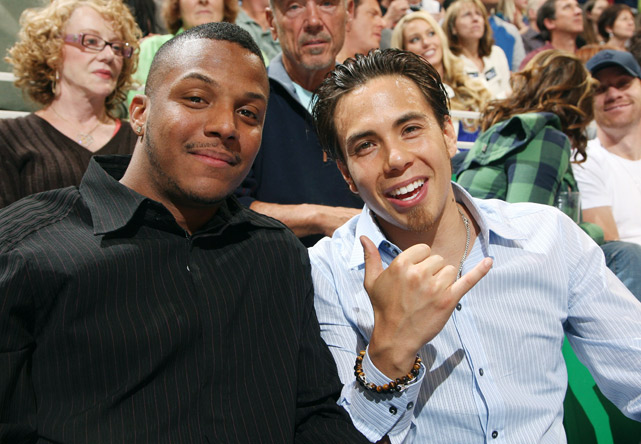Eight-time Olympic medalist speed skater Apolo Ohno (blue shirt), watches Game 4 of the Nuggets-Jazz series.
