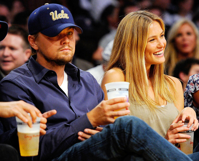 Explain this to us: How can you be sitting courtside at a Lakers-Thunder game with your SI Swimsuit model girlfriend and STILL look miserable? Leonardo DiCaprio, what's the deal?