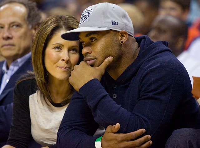 Panthers wide receiver Steve Smith and his wife, Angie, attend a Bobcats-Magic game in Charlotte.