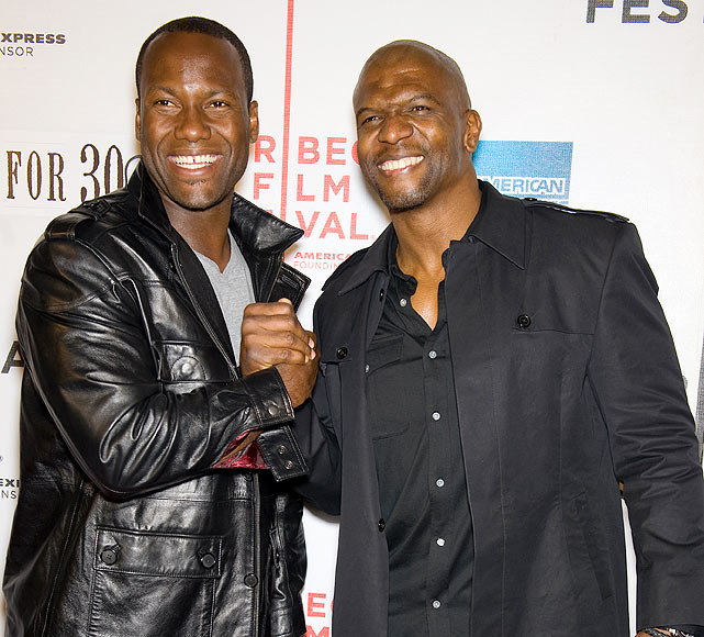 Garrard (left) hung with actor and former NFL player Terry Crews at the 'Straight Outta L.A.' premiere in New York.