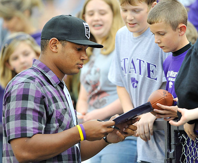 Freeman signed autographs for fans while taking in the spring game for his alma mater, Kansas State, at Bill Snyder Family Stadium in Manhattan, Kansas.