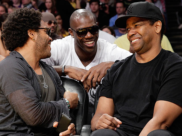 T.O. laughed it up with musician Lenny Kravitz (left) and actor Denzel Washington courtside at the Lakers-Nuggets game.