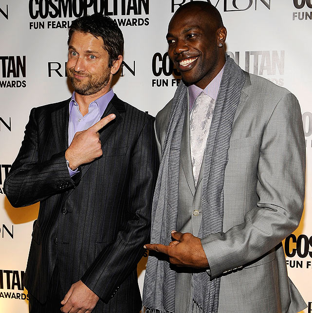 Named one of Cosmopolitan Magazine's Fun Fearless Males of 2010, T.O. yukked it up with actor Gerard Butler at the Mandarin Oriental Hotel.