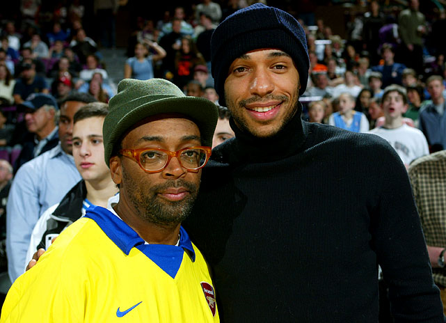 Henry, a longtime NBA fan, attends a Knicks-Heat game with filmmaker Spike Lee.