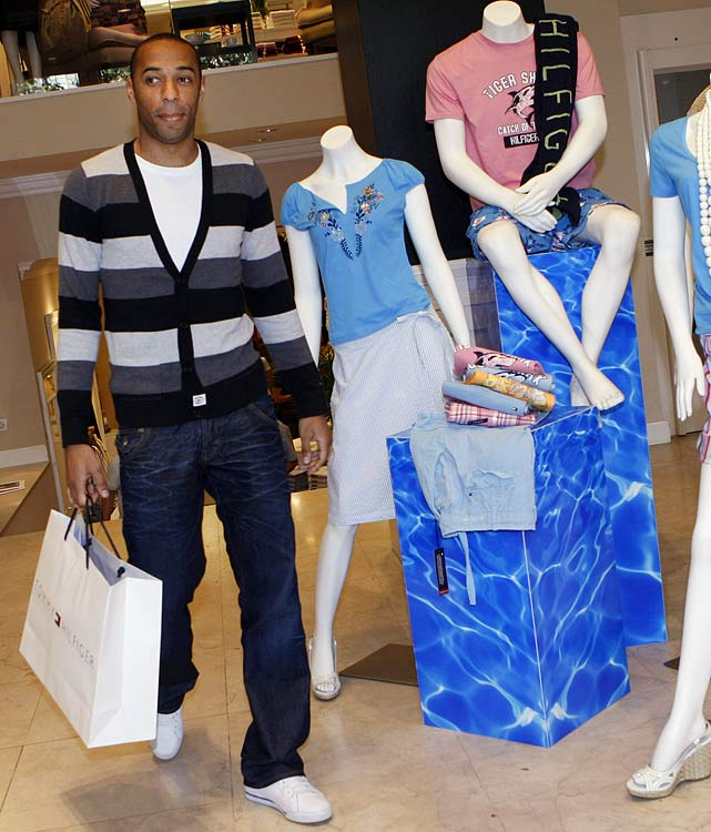 Henry walks through a Tommy Hilfiger store during his first shopping trip in the Catalan capital after joining FC Barcelona.
