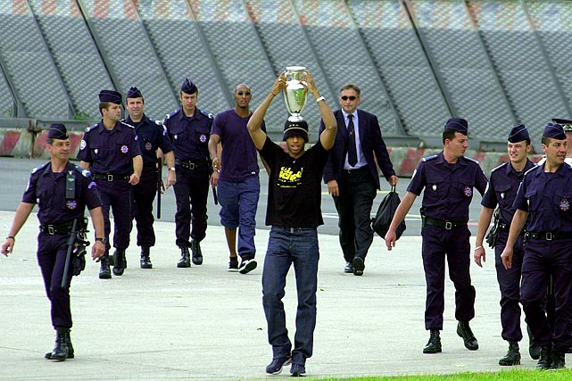 Henry holds the Euro 2000 trophy following France's 2-1 victory over Italy in the final.