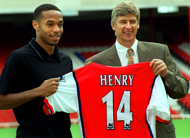 As Thierry Henry prepares for his first season in the MLS, SI presents some rare photos of the future New York Red Bull.    In this photo, Henry, 22, poses with Arsenal Manager Arsene Wenger after joining the team.