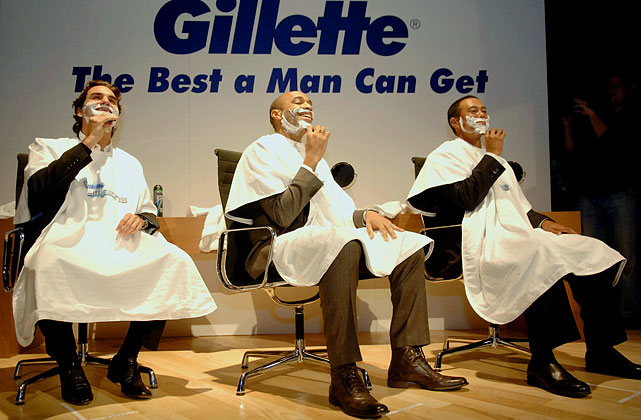 Henry enjoys a shave with Tiger Woods and Roger Federer during the launch of the new Gillette champions programme in Dubai.