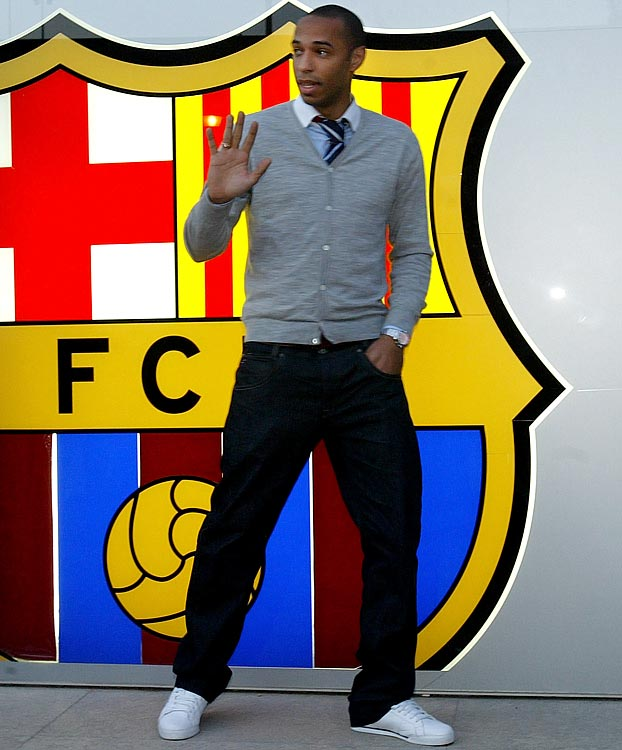 Henry waves outside the Barcelona football club shortly after joining the squad.