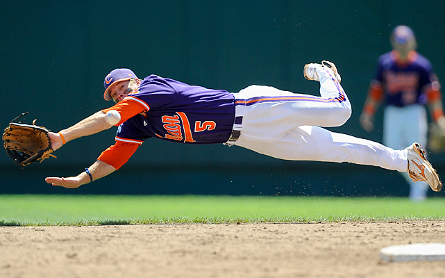 Clemson second baseman Mike Freeman leaps for, but cannot catch, a single hit by Arizona State's Zack MacPhee. Nevertheless, Clemson upset the top-seeded Sun Devils, roughing up ace Seth Blair.