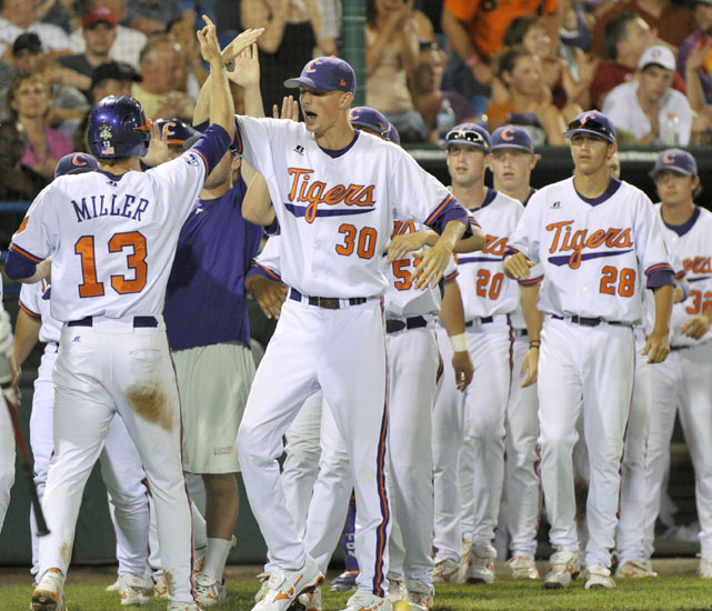 Clemson sophomore Brad Miller (left) high-fives teammates after crossing home plate during the Tigers' 6-4 victory over Oklahoma. Game 8 of the College World Series wasn't quite Isner-Mahut, but thunderstorms did suspend play for nearly 18 hours after Clemson built a 6-1 lead in an error-heavy sixth inning. Miller's routine fly ball to left field sparked the run, giving the Tigers enough of a cushion to hold off the Sooners.