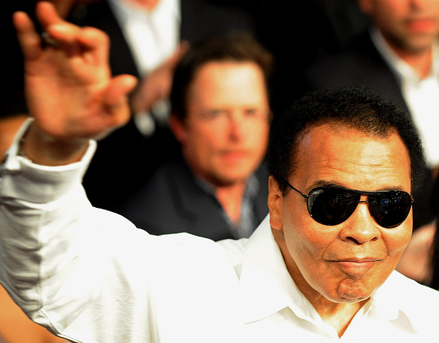 Muhammad Ali salutes the crowd before the start of the Floyd Mayweather Jr. and Shane Mosley welterweight fight at the MGM Grand Garden Arena on May 1, 2010 in Las Vegas.