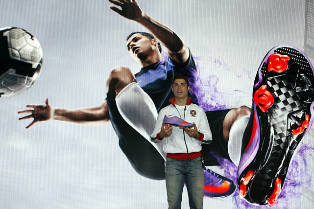 Ronaldo displays his new line of sneakers -- the Nike Mercurial Vapour Superfly II boot -- during a press conference in London.