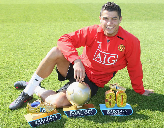 Ronaldo with his Barclays Player of the Year, Golden Boot and 30 League Goals awards at Carrington Training Ground in Manchester, England.