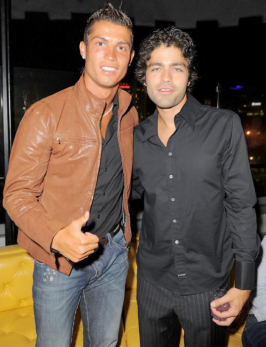 Ronaldo and Adrian Grenier strike a pose during a party in Hollywood.