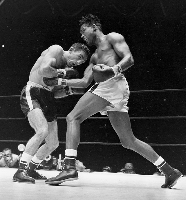 The middleweight title changed hands before a crowd of 38,000 when Basilio outpointed Robinson in a split decision. The fight is best remembered for the 11th round -- one of the most explosive frames in middleweight history. Robinson would regain the title for a record fifth time in the rematch.