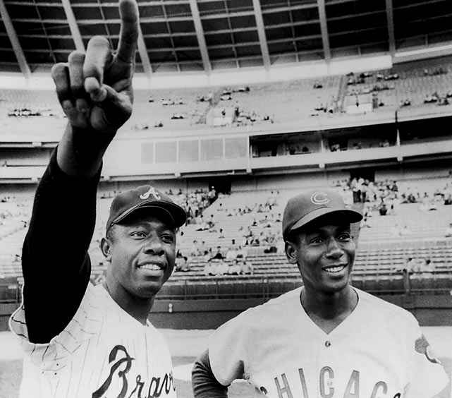 "Twice voted NL MVP, 11 times an All-Star, Ernie Banks is known to Chicago baseball fans simply as ""Mr. Cub."" Banks joined the 500 home-run club on May 12, 1970 at Wrigley Field off Pat Jarvis of the Atlanta Braves. Banks finished his career with 512 home runs (No. 21 all-time), and his No. 14 jersey was retired by the Cubs in 1982."