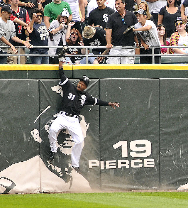 "White Sox lefty Mark Buerhle got some help from DeWayne Wise, who was inserted as a defensive replacement in center field in the ninth inning. Wise robbed Tampa Bay's Gabe Kapler of a home run with a ridiculous juggling catch at the left-center field wall, preserving Buerhle's perfecto as all of Chicago held its breath. The words ""The Catch"" were later imprinted on the outfield fence where Wise made the play."
