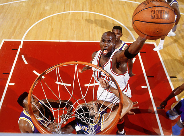 "The Bulls' 107-86 Game 2 win over the Lakers in the 1991 NBA Finals was relatively ordinary. That is except for one memorable play in which Michael Jordan caught the ball at the top of the key, drove the lane and leaped toward the right side of the rim, palming the ball with his arm outstretched. But at the last instant, sensing resistance from Lakers center Sam Perkins, Jordan switched hands and went lefty on the other side of the glass with astonishing ease in what would go down in history as ""The Move."""