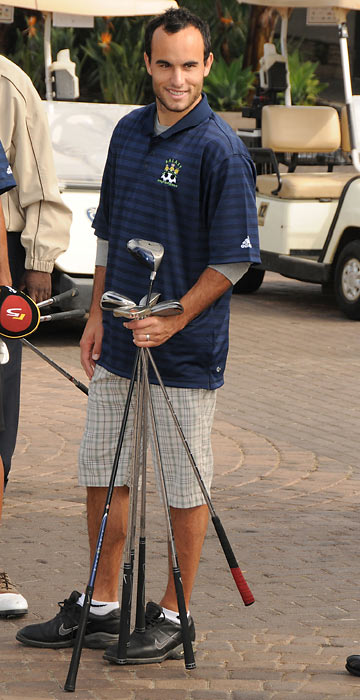 Donovan has his clubs ready at the Day Of The Links Golf Tournament at the Pacific Palms Resort in Industry, Calif.