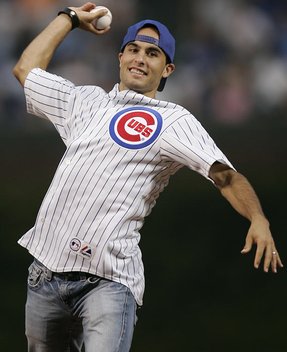 Donovan throws out the first pitch before the start of a Dodgers-Cubs game at Wrigley Field in Chicago.