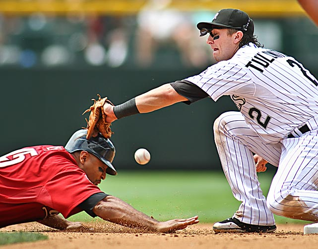Colorado Rockies shortstop Troy Tulowitzki mishandles a throw to second while attempting to tag Houston Astros Carlos Lee. The Astros won the game at Coors Field 5-4.