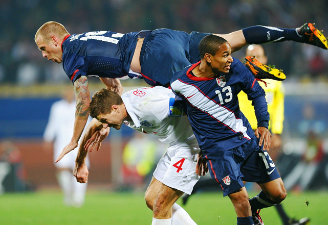 England's midfielder Steven Gerrard vies with U.S. defender Jay DeMerit and midfielder Ricardo Clark during a 1-1 tie on June 12  in Rustenburg.
