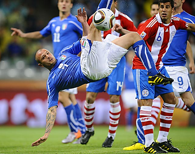 Italy's midfielder Simone Pepe trips as he kicks the ball during a match against Paraguay on June 14 at Green Point stadium in Cape Town.