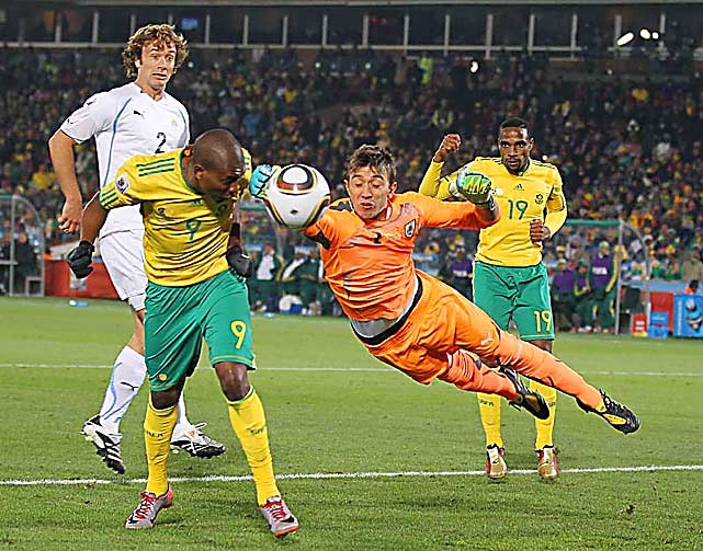 Uruguay's goalkeeper Fernando Muslera makes a save against South Africa's Katlego Mphela during a first round World Cup match in South Africa.