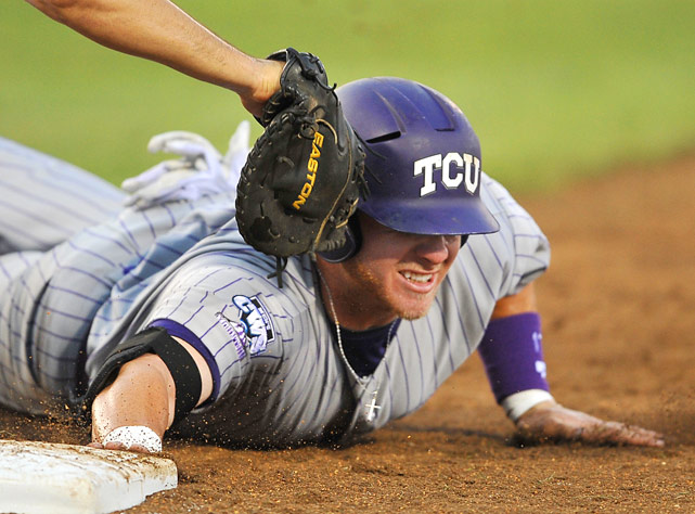 TCU's Matt Curry is tagged out at first during a 10-3 elimination loss to UCLA at the College World Series at Rosenblatt Stadium in Omaha, Neb., on June 26.