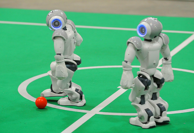 A robot dribbles the ball during practice at the RoboCup 2010 championship in Singapore on June 24. RoboCup 2010, the world's largest robotics event, came to Southeast Asia for the first time with close to 4,000 competitors from more than 40 countries.