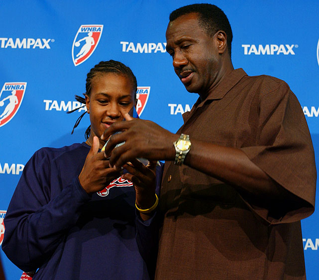 Like his daughter Tamika, Harvey Catchings was a defensive whiz during his years in the NBA. The two are seen here posing with her Defensive Player of the Year award in 2005.