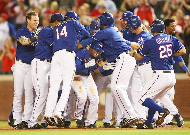 Texas Rangers short stop Elvis Andrus is mobbed after his game-winning single in the ninth against the Detroit Tigers on April 23 at Rangers Ballpark. The Rangers won 5-4.