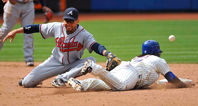 Jose Reyes of the Mets steals second as Atlanta Braves' second baseman Omar Infante misses the ball on catcher's David Ross's throwing error in the sixth inning. Reyes advanced to third on the error en route to a 3-1 home victory on April 24.