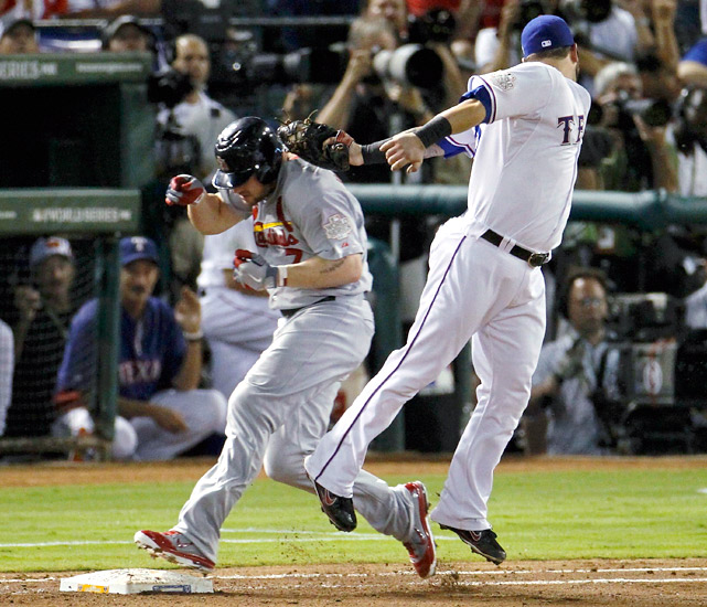 In the top of the fourth inning, Matt Holliday hit into an apparent 6-4-3 double play, but Elvis Andrus' throw from second pulled Mike Napoli off the bag. Replays clearly showed that Napoli tagged Holliday on the shoulder before he reached first, but Ron Kulpa's call stood. The Cardinals would go on to score four runs in the inning.
