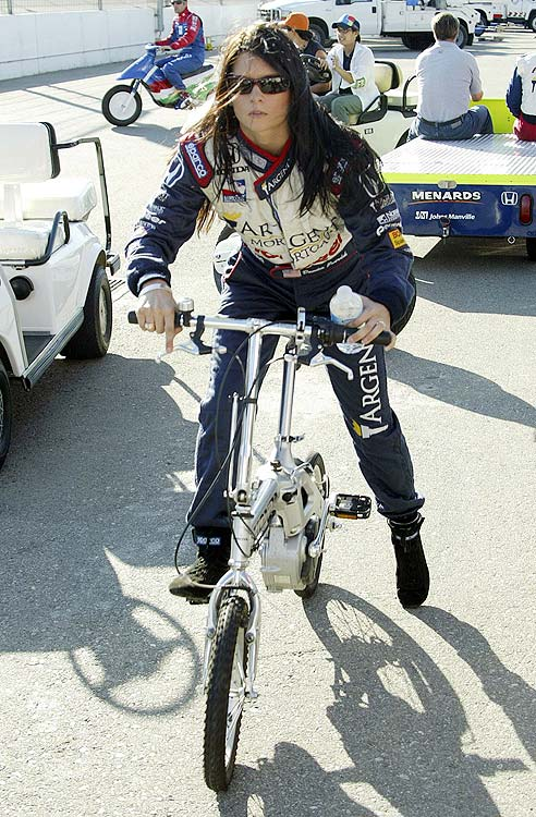 Patrick takes a break from the open-wheelers and rides her bicycle around California Speedway in October 2005.