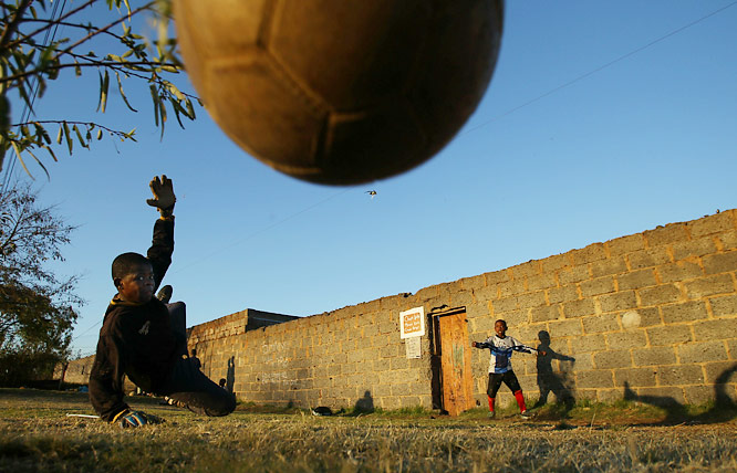 Children playing football on dirt pitches in a Soweto township on June 7. The 2010 World Cup kicks off in South Africa on Friday.