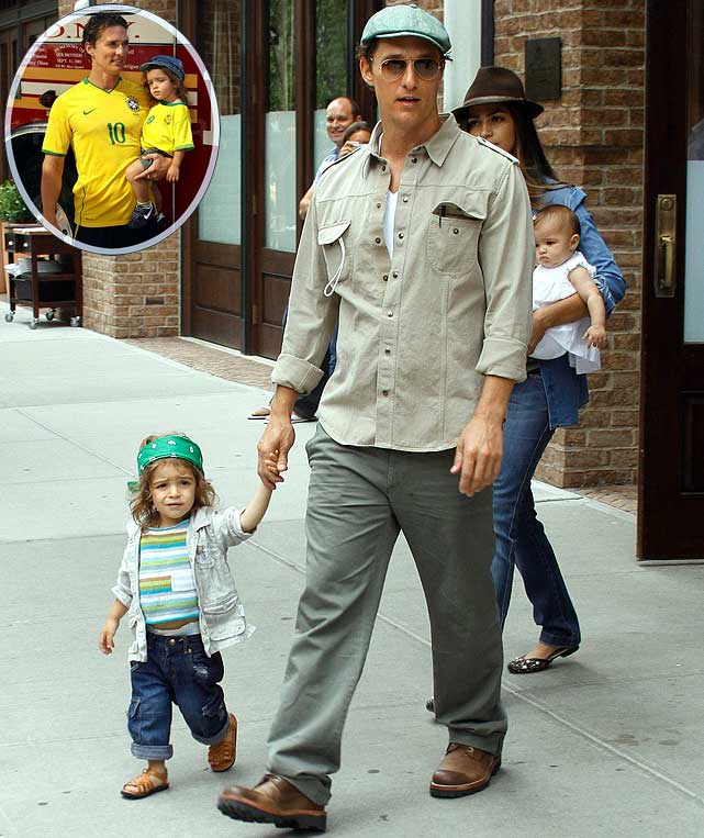 Family members are supposed to be supportive of one another.  So it's no surprise that Matthew McConaughey and son Levi showed their Brazilian pride by donning the team's World Cup jerseys around New York City.  Father and son rooted on mom Camila Alves' home country wearing a Kaka and Luis Fabiano jersey, respectively.